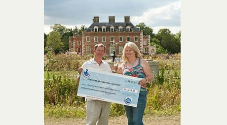 Pic by Samantha Cook Photography 280714.  Lottery Winners, Malcolm and Heather Dennett celebrate their success at Shaftesbury Estate, Wimborne St Giles, Dorset. They also celebrate along with their horse, Doogle.